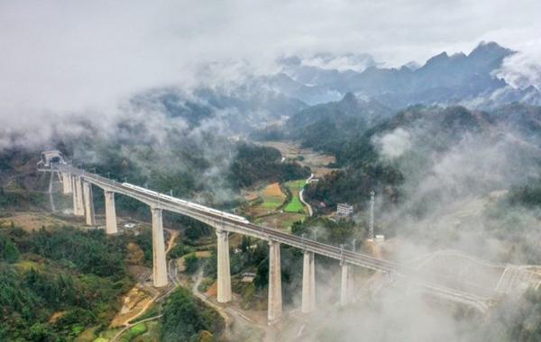Bullet Train Runs Across Bridge in Longshan County